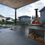 Cuisine extérieure avec barbecue et espace bar